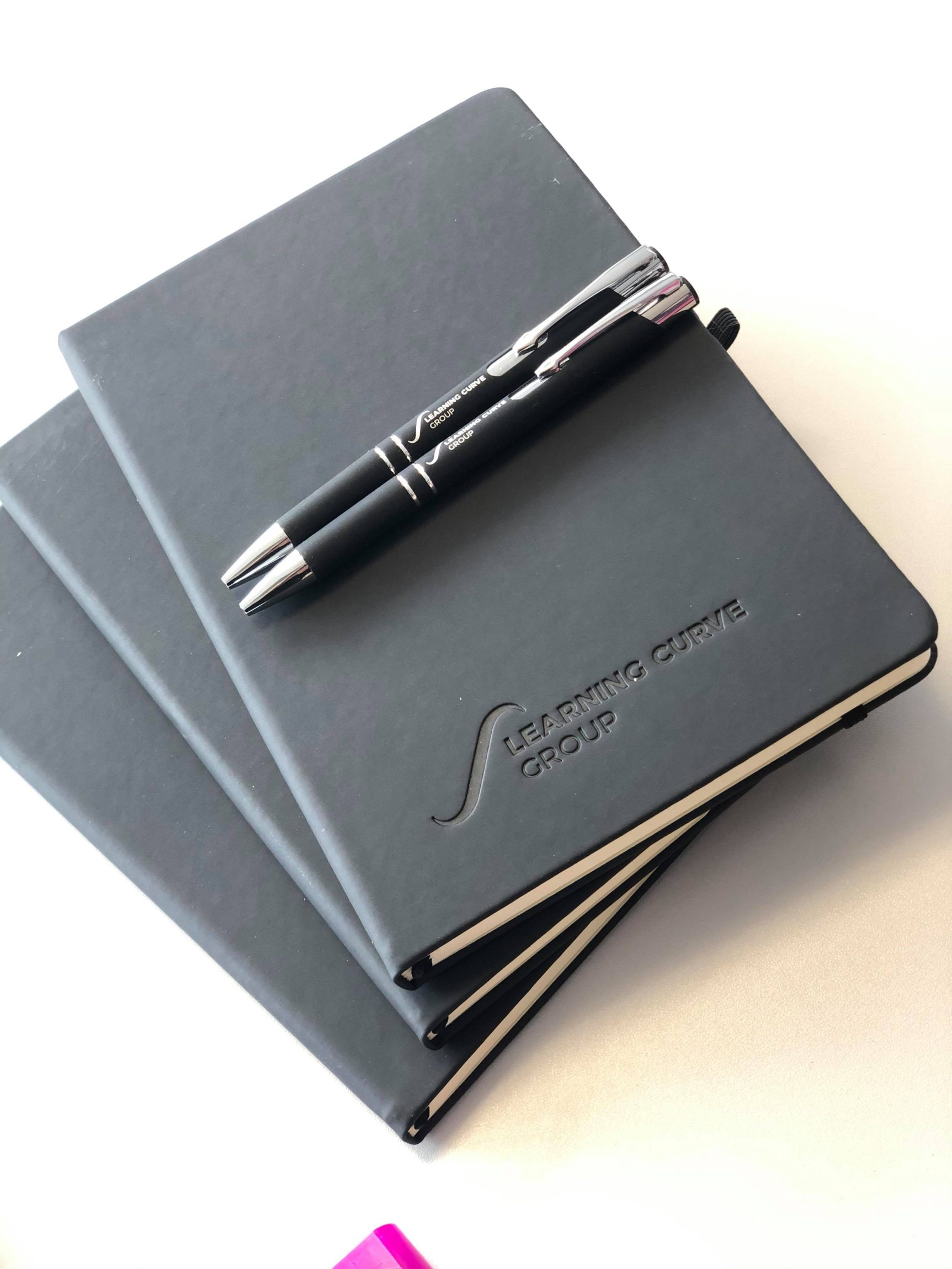 Branded soft touch notebook in grey logo embossed